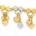 Charm Armband teils mit Brillanten in 750 Tricolor Gold